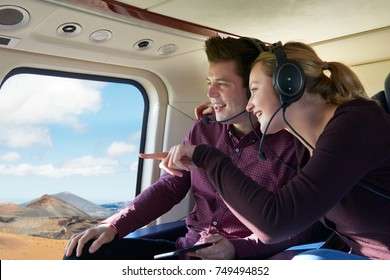Couple On Vacation Taking Ride In Helicopter