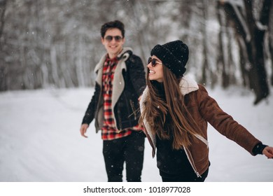 Couple on valentine's day in winter forest