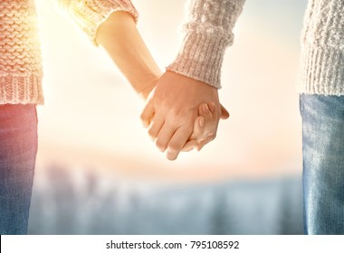 Couple on Valentines day. Woman and man holding hands.