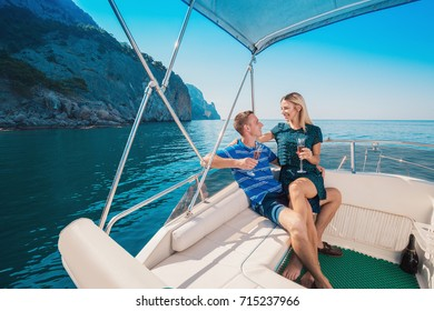 Couple on a Yacht. Luxury vacation on the Boat young man and woman. Sailing the Sea. Cruise.