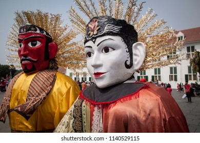 A couple of Ondel-ondel, the famous puppet icon of Jakarta, the city of Indonesia.