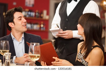 Couple ordering dinner in a restaurant