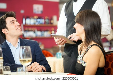 Couple ordering food in a restaurant