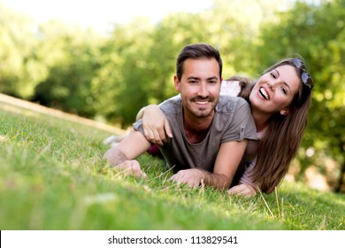 Couple outdoors enjoying a summery day looking happy