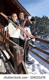 Couple outside a ski lodge