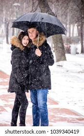 Couple outside in snowy weather