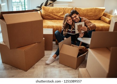 Couple packing up boxes for move into new apartment
