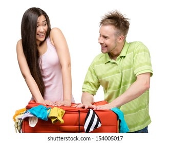 Couple packs up suitcase with clothing for journey, isolated on white. Concept of romantic vacations and lovely honeymoon