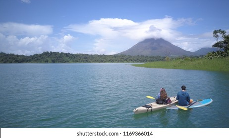 A couple paddling at the Arenal lake