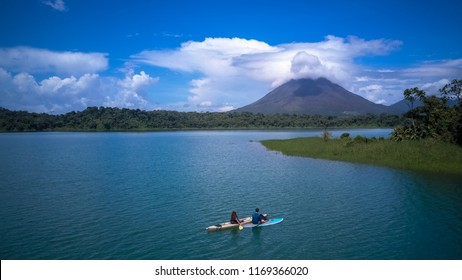 A couple paddling at the Arenal lake