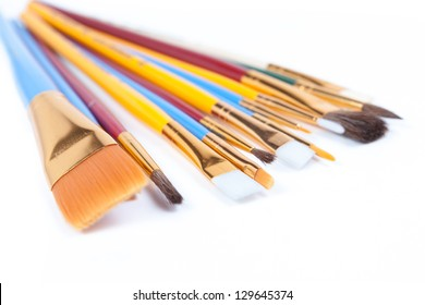 couple of paintbrushes isolated on white background