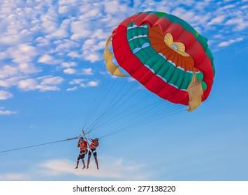 Couple parasailing on Batu Feringghi beach in Penang, Malaysia