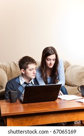 A couple paying bills by using online banking at home