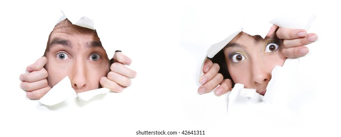 couple peeping through hole in white paper