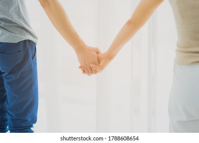 Couple people in casual outfit holding hand together with romatic mood in white background