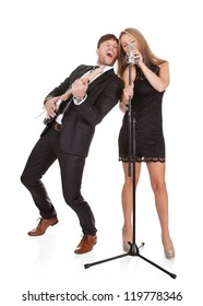 Couple performs duet sharing same microphone to everybody.