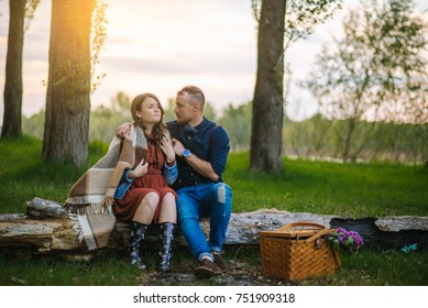 Couple with picnic basket outdoors. couple with picnic basket. Valentine's Day