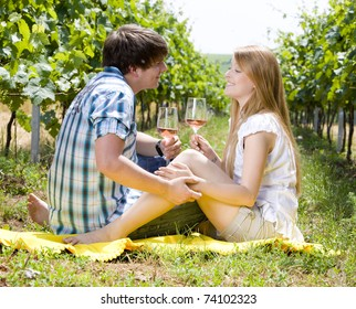 couple at a picnic in vineyard