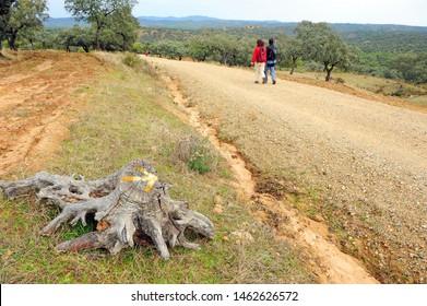 Couple of pilgrims between Castilblanco and Almaden de la Plata province of Seville Andalusia Spain. Via de la Plata is the Way of St James (Camino de Santiago) from Seville to Santiago de Compostela