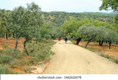 Couple of pilgrims between Castilblanco and Almaden de la Plata province of Seville Andalusia Spain. Via de la Plata is the Way of St James (Camino de Santiago) from Seville to Santiago de Compostela