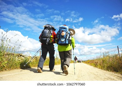 Couple of pilgrims in the Via de la Plata near Alcuescar, province of Caceres, Spain. Via de la Plata is the name of St. James Way (Camino de Santiago) from Seville to Santiago de Compostela.