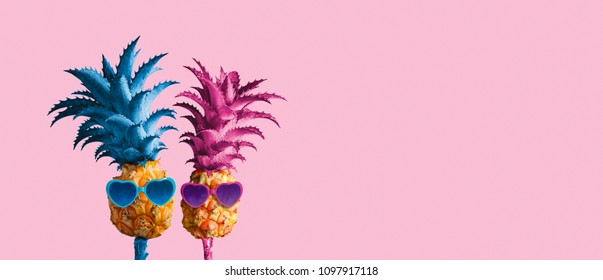 Couple pineapples on pink background minimal summer love concept