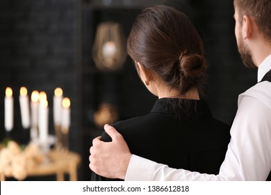 Couple pining after their relative at funeral