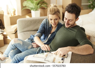 Couple planning out furniture before they unpack