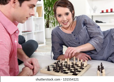 Couple play chess