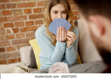 Couple playing with cards.