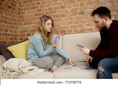 Couple playing cards at home.