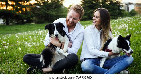 Couple playing with dogs