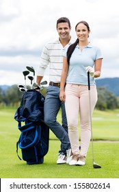 Couple playing golf looking very happy at the course