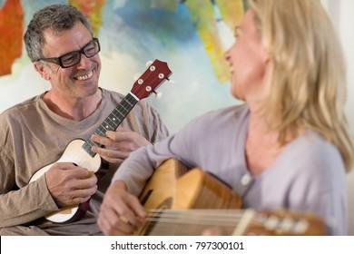 Couple playing guitar and ukulele