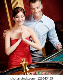 Couple playing roulette wins at the casino
