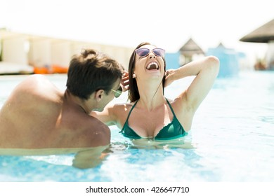 Couple in the pool in the summertime