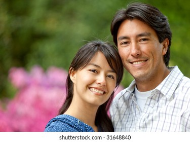 couple portrait looking happy and smiling outdoors