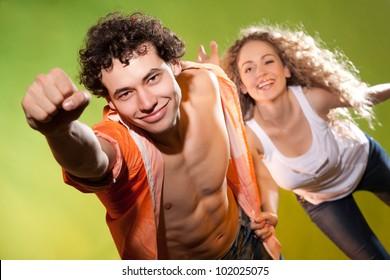 a couple posing in studio