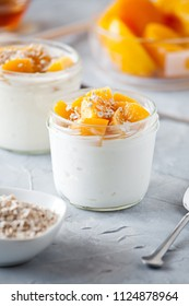Couple of pots of yogurt with organic poached peaches