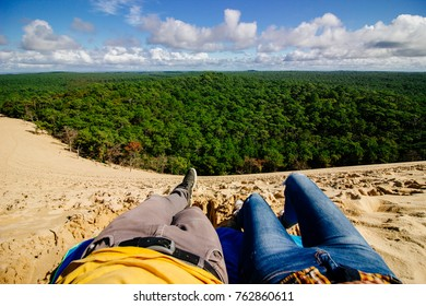 Couple POV, lying on top of Dune of Pilat sand dune in Arcachon (France)