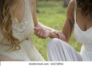 Lesbian hand under dress