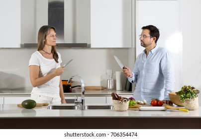 couple preparing food in a kitchen