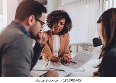 Couple preparing to sign a contract of sale