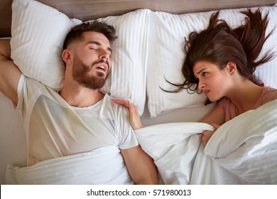 couple Problem with snoring in bed
