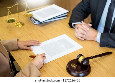 couple problems sitting a marriage Golden wedding rings judge gavel deciding on marriage divorce signing divorce documents or premarital agreement provide legal advice of lawyer and consoling clients