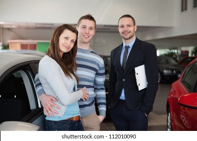 Couple purchasing a car in a dealership