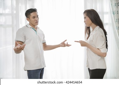Couple are quarrel in the house