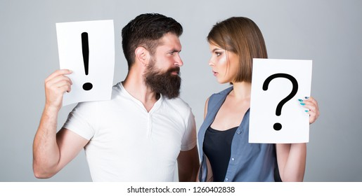 Couple in quarrel. Question mark. A woman and a man a question, exclamation point. Quarrel between two people. Pensive man and a thoughtful woman. Husband and wife not talking, being in quarrel.