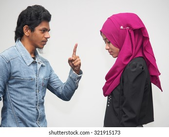 A couple quarreling with the male being abusive.