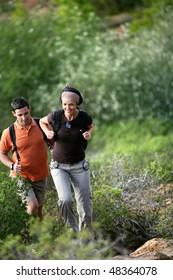 Couple rambling in countryside